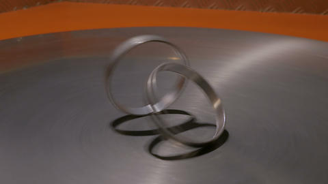 Moving rings on metal turning surface at technology museum Footage