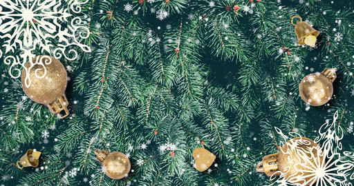 Christmas background with fir branches, snowflakes and golden balls. Top view Animation