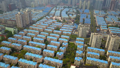 Aerial view of blue houses. Residential neighborhood. Urban housing development from above. Top Footage