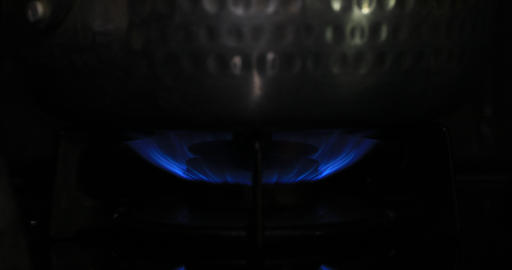 Ignition of the heat under the pot in the kitchen Footage
