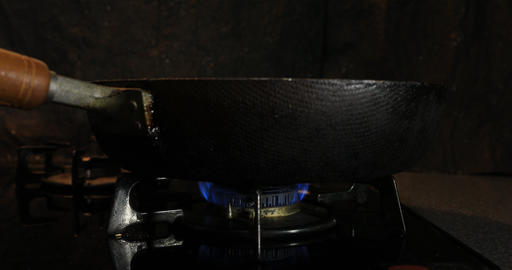 Ignition of the heat under the pan in the kitchen Footage