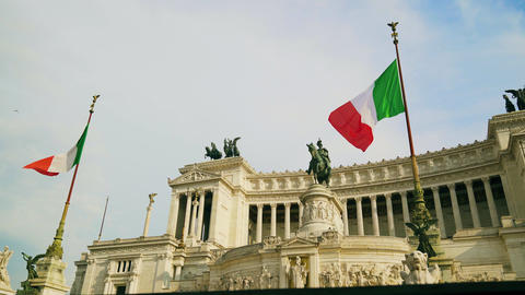 Italian flag waving against the equestrian statue representing the Italian 4k Live Action