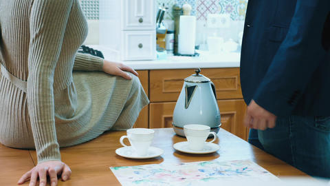 Unrecognizable couple drinking coffee in the kitchen Footage