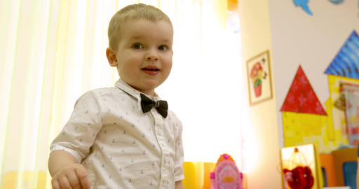 Cute little kid boy indoor Stock Video Footage