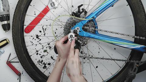 Woman mechanic fixing a bicycle wheel Footage