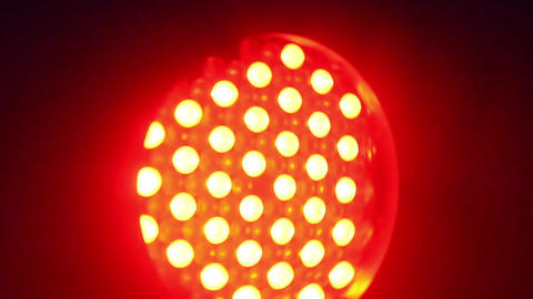 Rotating colorful red LED spotlight Footage