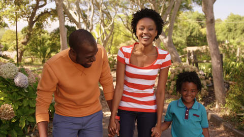 Cute family is walking in the park Live Action