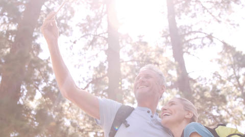 Hiker couple taking selfie while hiking Live Action