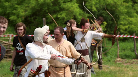 Archers shoot bows at the tournament Live Action