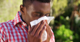 Portrait of man is blowing his nose Footage
