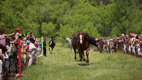 Girls don Cossacks riding on horses Footage
