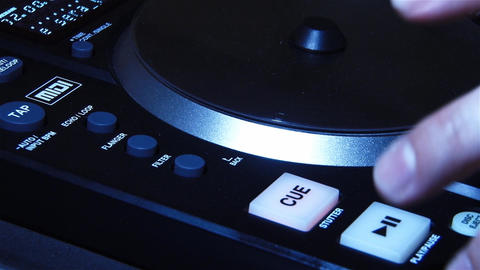 Hand press the buttons of a DJ mixer while mixing music 03 Footage