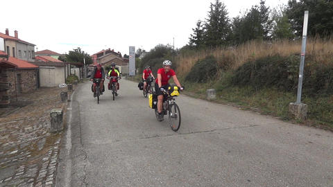 Group of cyclists who went on a journey on a road afaltat at the exit of a villa Footage