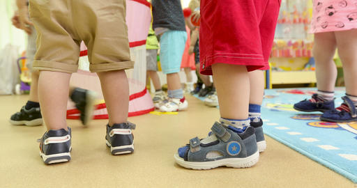 Unknown children stand and play in kindergarten Footage