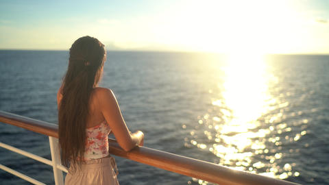 Cruise ship vacation travel woman enjoying sunset at sea on boat Live Action