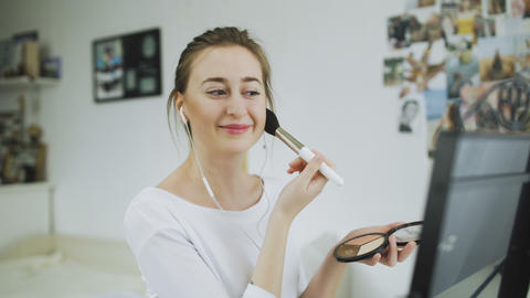 Woman With Beauty Face Applying Makeup and listen music Footage