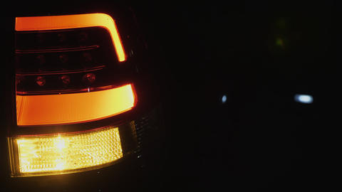 Automobile taillight blinks at dark background Footage