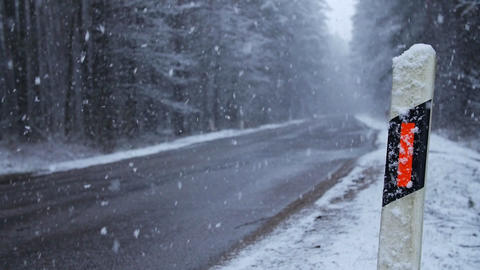 Winter road with lots of snow. Bad winter road conditions. View through roadside Footage