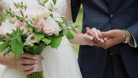 Newly married couple holding hands close-up Footage