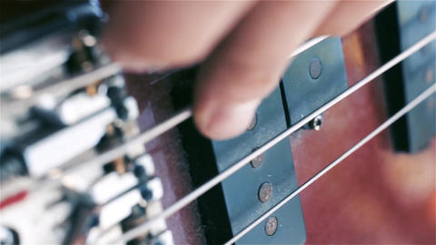 Bass Guitar. Fingers Fingering The Strings Footage