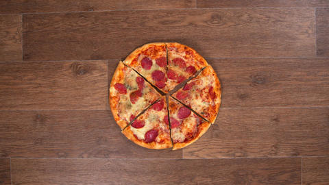 Pieces of pizza are separated and moved away in different directions and then Archivo