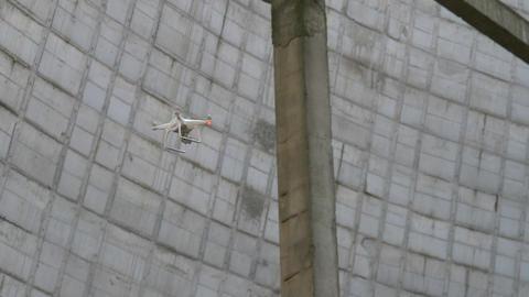 Drone flies between building structures Live Action