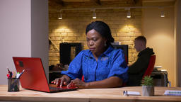 Closeup shoot of adult african american businesswoman using the laptop and being Footage