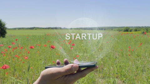 Hologram of Startup on a smartphone Footage