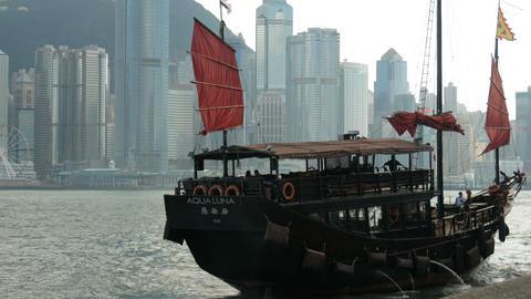 Hong Kong with traditional cruise sailboat at Victoria harbor Footage