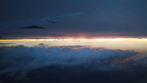 Above morning clouds from airplane GIF