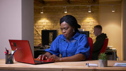 Closeup shoot of upset adult african american businesswoman using the laptop and Footage