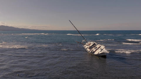 Drone flight round ship wreck in Costa Rica in the sunset Live Action