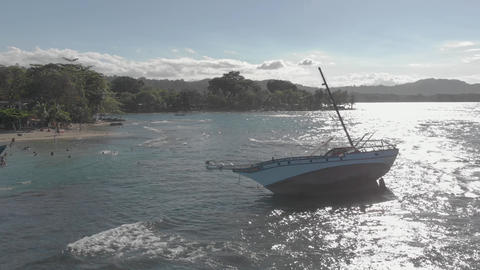 Flight in sunset round ship wreck in Costa Rica - Caribbean coast line Footage