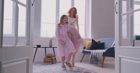 Active young mom babysiter and cute little kid daughter jumping dancing in Footage