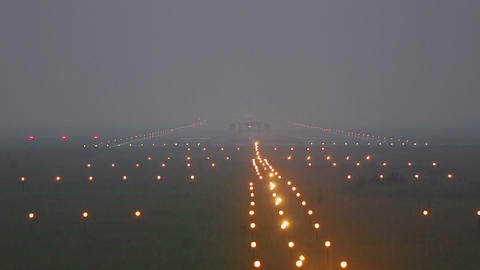 Airplane taxiing on runway in fog Live Action