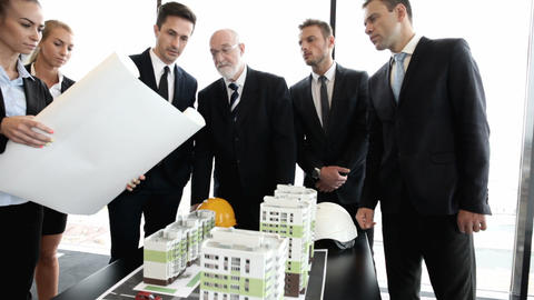 Architects and investors with model of houses Footage