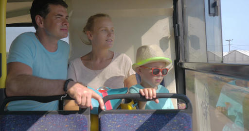 Family with child traveling by bus and looking out the window Footage