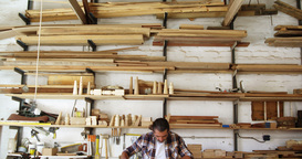 Facing view of carpenter working building a piece of... Stock Video Footage
