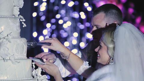 Bride and groom cut wedding cake Footage