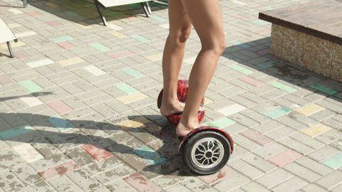 Modern young woman in bikini having fun with Hoverboard Footage