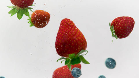 Mixed Berries Spashing in Refreshing Water Live Action