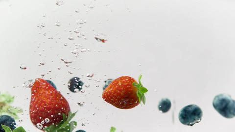 Strawberries and Blueberries Splashing in Cold Water Footage