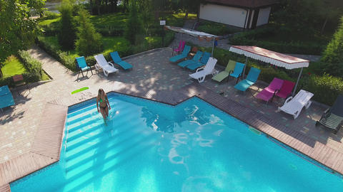 Top of view of aerial flying drone view of swimming pool in resort Footage