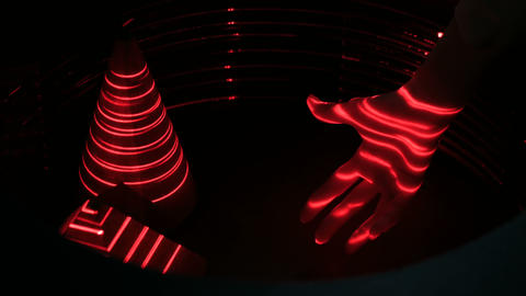 Optical illusion with red lasers, woman hand and geometric objects Footage