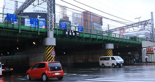 Moving cars at the crossing in Shinjuku Tokyo rainy day Footage