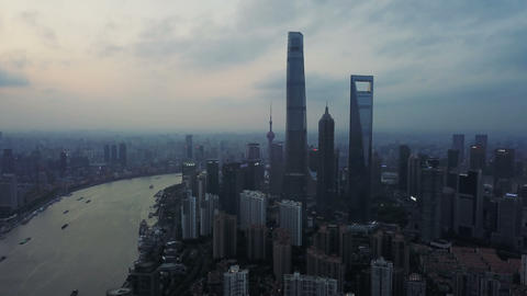 Aerial view of skyscraper and high-rise office buildings in Shanghai Downtown, China. Financial Live Action