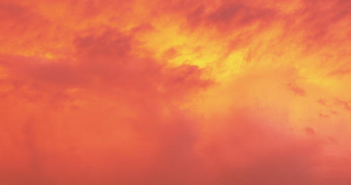 Beautiful dramatic nature clouds in red, orange, purple sunrise. Meteorology Live Action