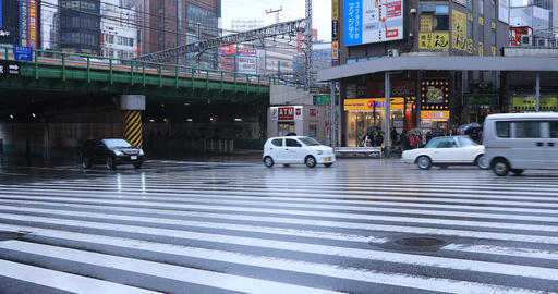 Moving cars at the crossing in Shinjuku Tokyo rainy day Stock Video Footage