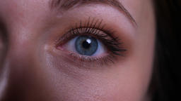 Closeup half face portrait of young pretty caucasian brunette womans eye looking Footage