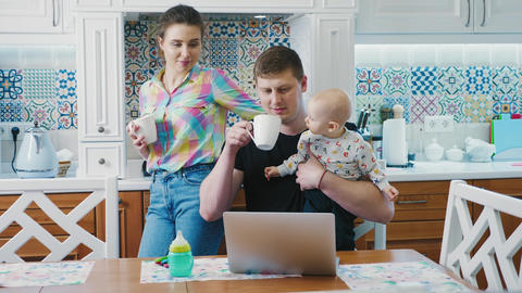 Happy family in the kitchen in the morning Live Action